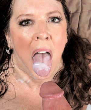 Hot cougar Nicky White catches a load of cum on her tongue from her boy toy