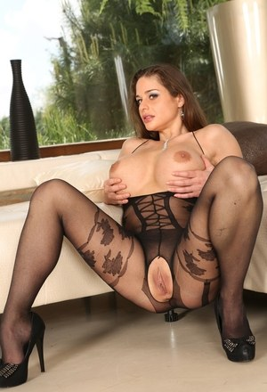 Hot MILF Cathy Heaven bares her huge tits wearing a crotchless bodystocking