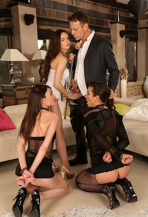 Kinky couple remove handcuffs from female sex slaves before FFFM sex action