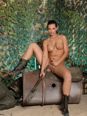 Hot solo model Eve Angel rams a huge toy up her trimmed snatch in boots