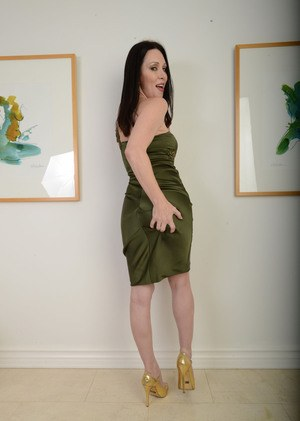 Hot mature lady RayVeness pulls out her big tits as she removes her dress