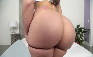 Brunette solo model Gia Paige bares her phat ass prior to masturbating