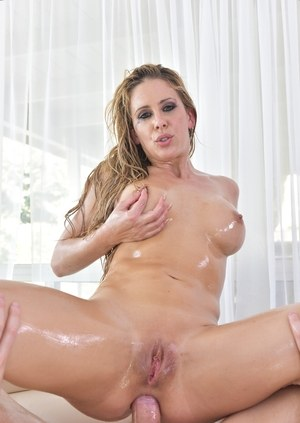 Pornstar Cherie DeVille is all oiled up and ready for a deep anal fucking