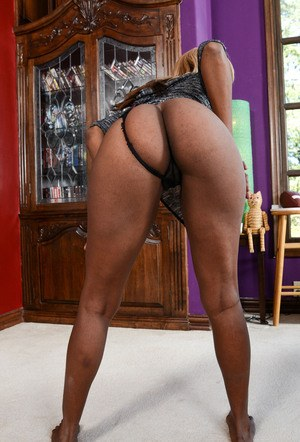 Black first timer Ebony Desire spreads her trimmed bush on a director's chair