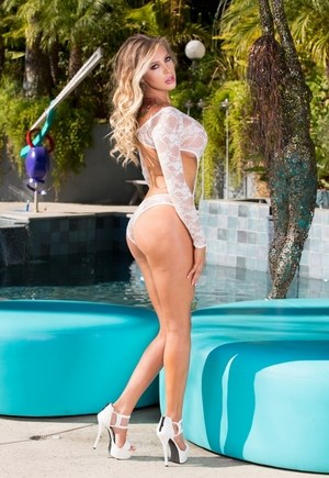 Sexy blonde chick Samantha Saint takes off her see thru lingerie outside