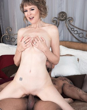 Older woman Jamie Foster undresses her boy toy before getting fucked