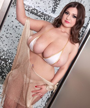 Plumper Demmy Blaze whips out her hooters in shower and licks her own nipples