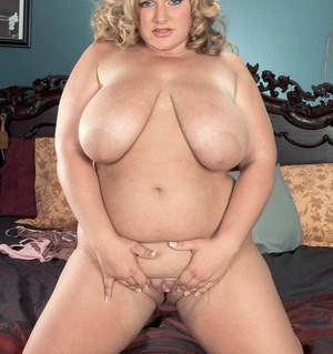 Older BBW Veronica Vaughn plays with her huge boobs before spreading her pussy