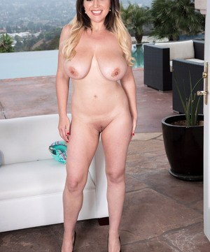 Solo model Aurora Rose unleashes her big natural breasts out on the patio