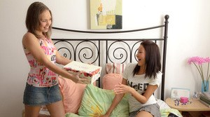 Young lesbians Ilina and Laura break out the sex toys on their bed