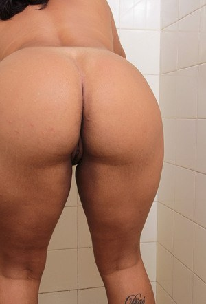 Chubby black girl wets her pussy on toilet seat before showing her fat ass off