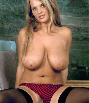 Big boobed MILF Ines Cudna sticks a toy in her twat wearing black nylons