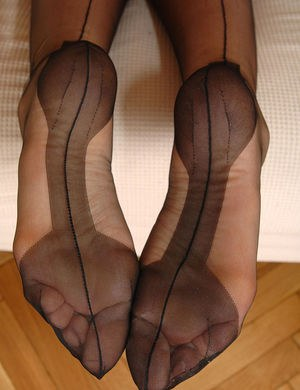 Gorgeous females roll nylons over legs and pretty feet before eating pussy