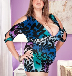 Overweight solo model Michelle May exposes her knockers as she undresses