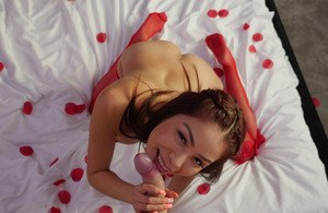 Asian gf Samantha Parker gives her guy a blowjob wearing red nylons