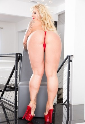 Blonde female Ryan Conner flashes her big tits before baring her big butt