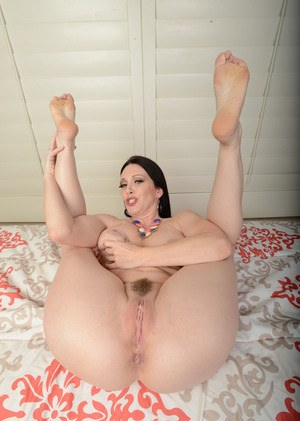 Brunette MILF RayVeness flashes a no panty upskirt prior to undressing