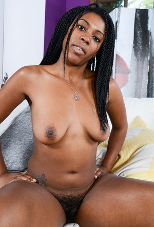 Black amateur Janelle Taylor flaunts her bare boobs and bush in the nude
