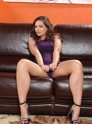 Stunning MILF Eve Angel flaunts her tight ass in a purple thong