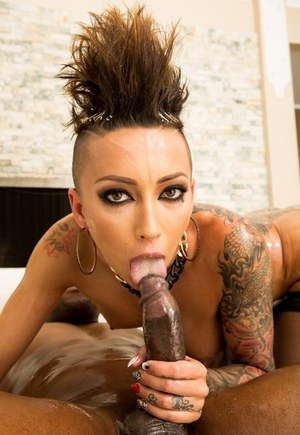 Tattooed female Bella Bellz gets ass fucked by a long black cock