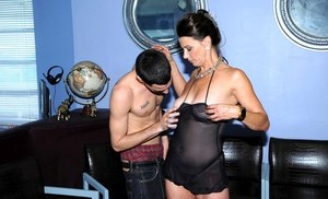 Brunette cougar Mimi Moore sucks her boy toy's dick in sheer black lingerie