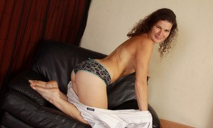 Older solo model with hairy legs releases her hairy bush from her underwear