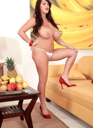 Sexy MILF Leanne Crow exposes her huge boobs while eating a banana
