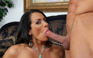 Busty mature mom Reagan Fox provides oral sex in the nude