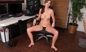 Middle-aged secretary Alice spreads her labia lips wide open in office chair