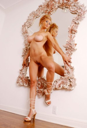 Hot Asian female Tera Patrick flaunts her large tits in front of a mirror