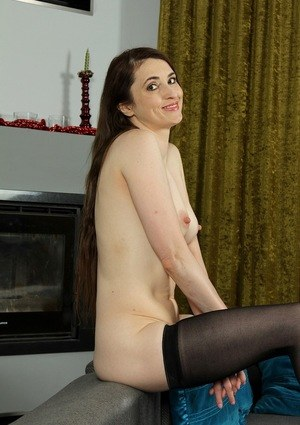 Middle-aged lady finds her nipples getting hard while posing in the nude
