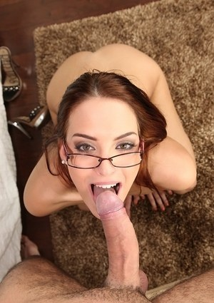 Nude chick Lyen Parker gets down on her knees to suck cock with her glasses on