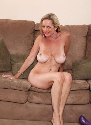 Older Milf Cassy Torri Unveils Her Large Boobs As She Gets Naked On A Couch