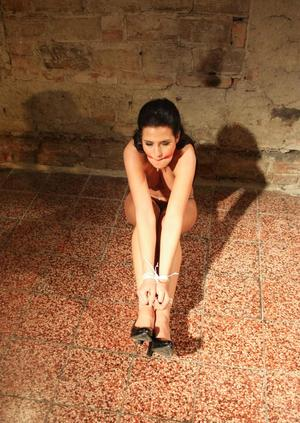 Leggy brunette Nicole Vice struggles with wrists and ankles tied together