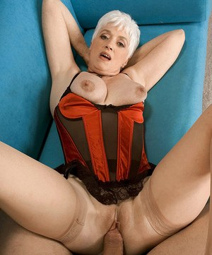 Hot nan Suzy seduces a younger man in sexy lingerie and tan nylons