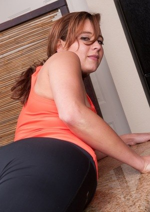 MILF next door type removes her yoga pants on kitchen counter