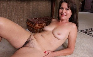 Older woman flashes her white panties prior to removing all her clothes