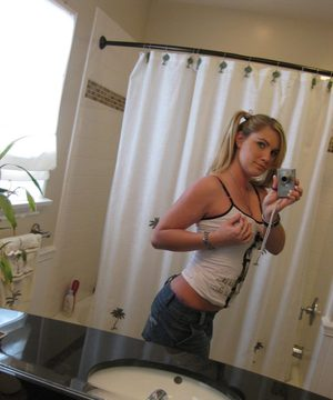 Blonde gf Hayden Night snaps selfies in bathroom while licking a lollipop