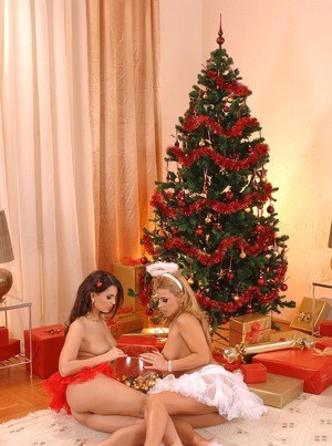 Lesbians Dorothy Black & Eve Angel bring out the sex toys at Christmas time