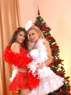 Lesbians Eve Angel & Dorothy Black have sex afore Xmas tree in frilly outfits