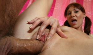 Cute redhead Cindy Sterling gets banged by a large cock in pigtails