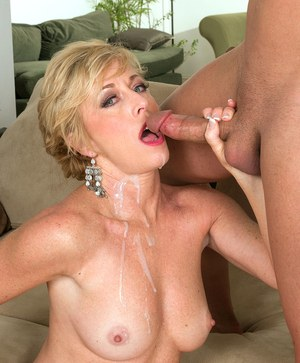 Older blonde lady Chanel Carrera flaunts her nice tits while sucking cock