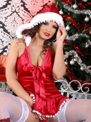 Hot solo model Eve Angel poses in sexy Christmas themed lingerie
