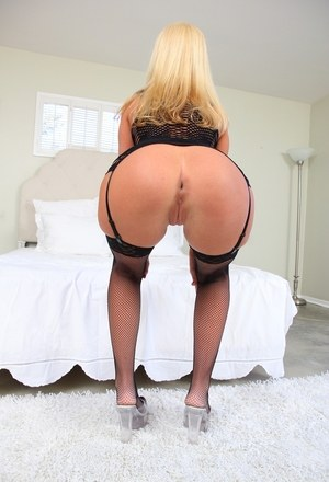 Hot blonde female Roxy Raye flaunts her juicy ass in black lingerie and nylons