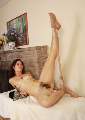 Solo model Sunshine reveals her unshaven armpits and pussy as she undresses