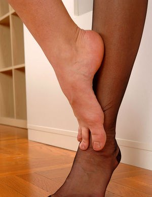 Sexy solo girl Cherry Jul removes RHT nylons from her sexy legs and feet