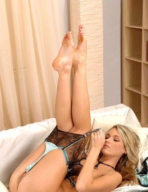 Hot blonde MILF Cherry Jul slowly removes her RHT nylons atop white sheets
