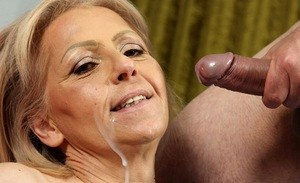 Older lady drips jizz down her cheek and chin after being throat fucked