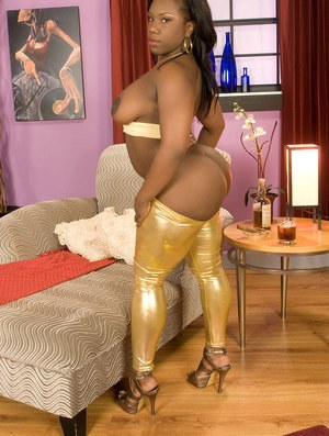Black solo girl Morgan Cummings slides her gold pants over her big booty