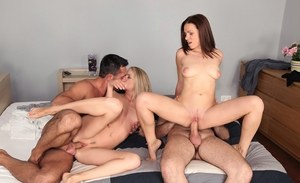 Swinging chicks taste each others man's jizz during a foursome